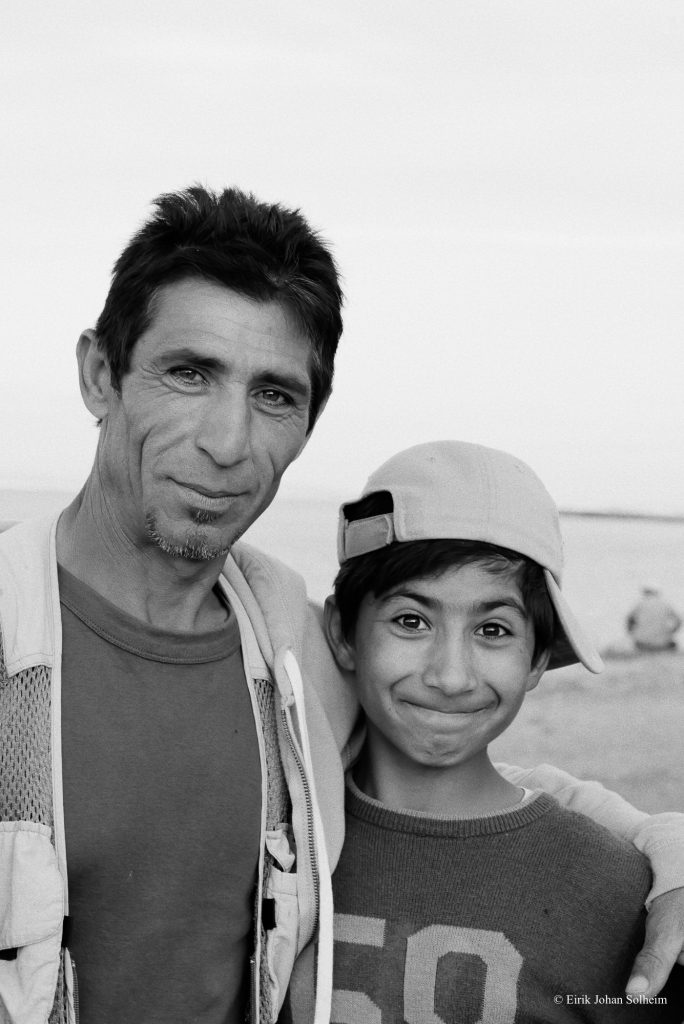 Refugee father and son in Souda camp on Chios Island in Greece